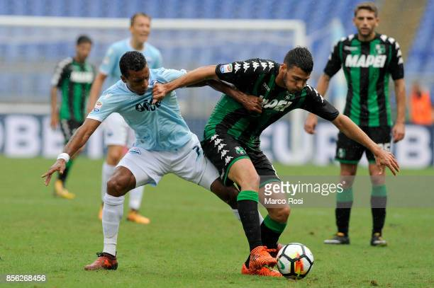 Nani of SS Lazio compete for the ball with Federico Peluso of US Sassuolo during the Serie A match between SS Lazio and US Sassuolo at Stadio...