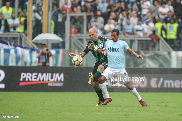 Nani of SS Lazio compete for the ball with Paolo Cannavaro of US Sassuolo during the Serie A match between SS Lazio and US Sassuolo at Stadio...