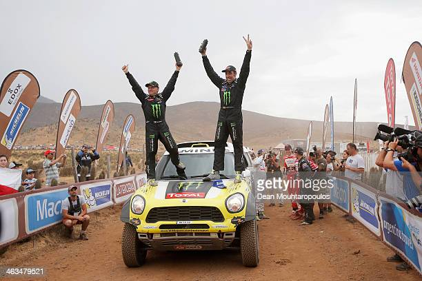Nani Roma of Spain and Michel Perin of France for MINI and the Monster Energy XRaid Team celebrate on the finish line after winning the 2014 Dakar...