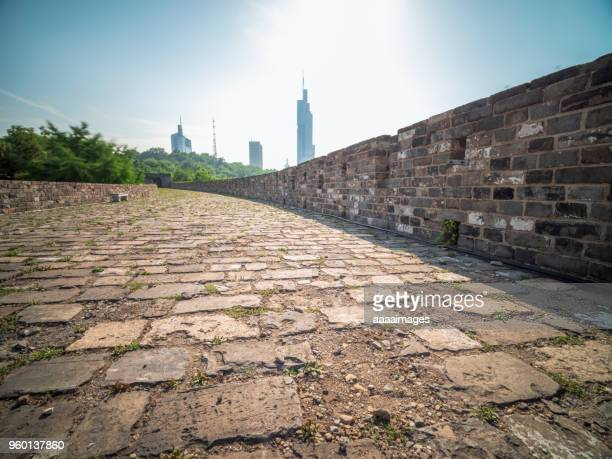 nanjing ancient city wall front of city skyline - nanjing stock pictures, royalty-free photos & images