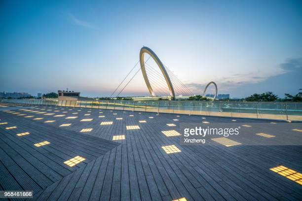 nanjing eye bridge at dusk - nanjing stock pictures, royalty-free photos & images
