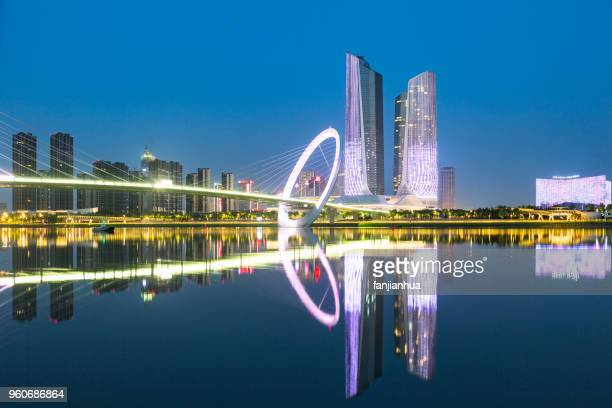 nanjing eye footbridge with youth olympic village twin towers - 南京市 ストックフォトと画像