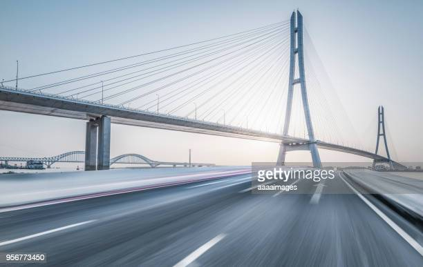 nanjing no.3 yangtze river bridge with blurred motion traffic - suspension bridge stock pictures, royalty-free photos & images