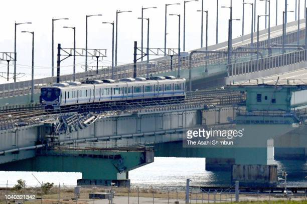 A Nankai Electric Railway Co train leaves for the first time since Typhoon Jebi cut off the main access route to Kansai International Airport on...