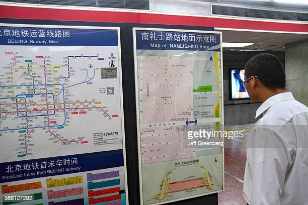 Nanlishilu Subway Station Line 1 Asian man looking at street map route