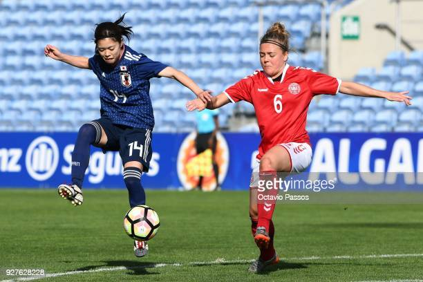 Nanna Christiansen of Denmark competes for the ball with Yui Hasegawa of Japan during the Women's Algarve Cup Tournament match between Denmark and...