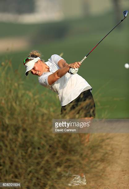 Nanna Koerstz Madsen of Denmark plays her fourth shot on the tenth hole during the first round of the 2016 Omega Dubai Ladies Masters on the Majlis...
