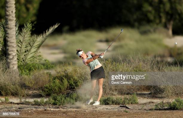 Nanna Koerstz Madsen of Denmark plays her third shot on the par 5 10th hole during the first round of the 2017 Dubai Ladies Classic on the Majlis...