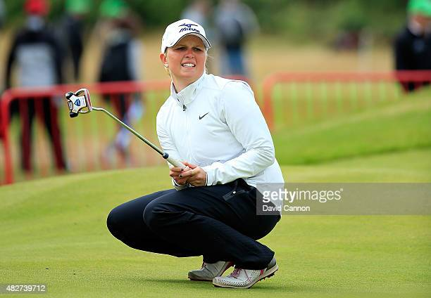 Nanna Koerstz Madsen of Denmark reacts to a putt on the 18th green during the Final Round of the Ricoh Women's British Open at Turnberry Golf Club on...