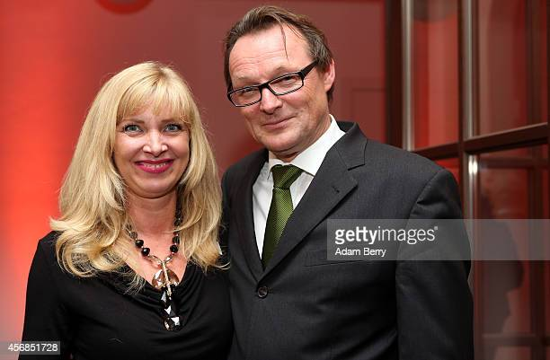 Nanna Kuckuck and Dirk Ullmann arrive for a literary-musical evening hosted by Berenberg Bank at Humboldt Carre on October 8, 2014 in Berlin, Germany.