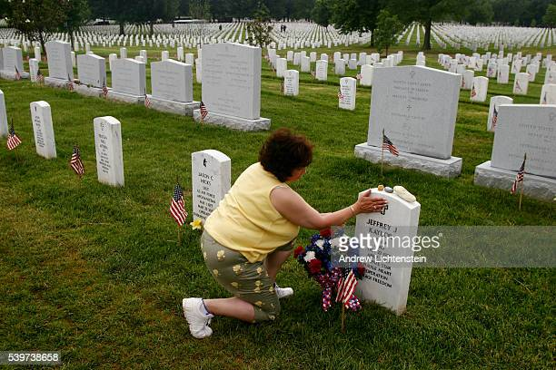 Nannette Cosbey MotherInLaw to Jeffrey Kaylor a soldier killed in combat in Iraq prays at his gravesite The day before Memorial Day weekend at...