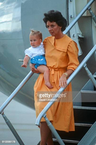 Nanny Barbara Barnes carries Prince William off of a plane at Melbourne Airport Australia on April 16 at the end of the Royal Tour of Australia