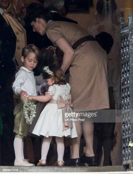 Nanny Maria Teresa Borrallo with Prince George of Cambridge and Princess Charlotte of Cambridge attend the wedding of Pippa Middleton and James...