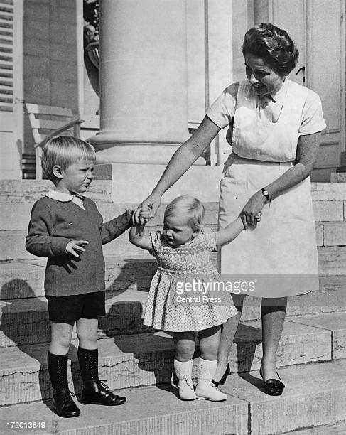 Nanny takes Prince Philippe of Belgium and Princess Astrid of Belgium for a stroll in the grounds of the Chateau of Belvedere, Brussels, 21st October...