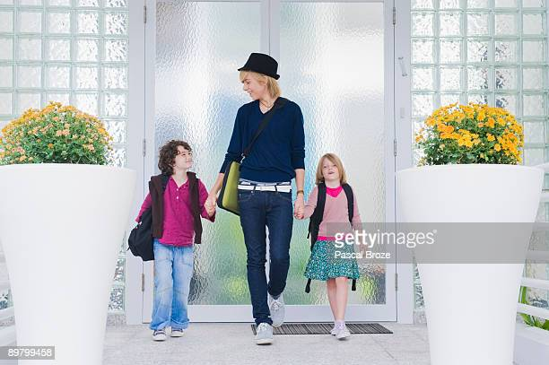 Nanny with children leaving for school
