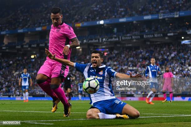 Nano Mesa of Levante UD competes for the ball with Aaron Martin of RCD Espanyol during the La Liga match between Espanyol and Levante at CornellaEl...