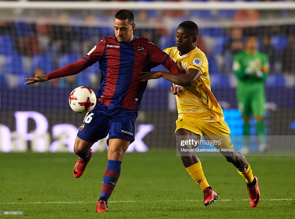 Nano of Levante competes for the ball with Marlos Moreno (R) of Girona during the Copa del Rey, Round of 32, Second Leg match between Levante and Girona at Ciudad de Valencia Stadium on November 28, 2017 in Valencia, Spain.