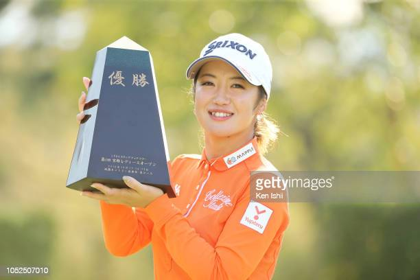 Nanoko Hayashi of Japan celebrates on the practice green after winning the final round of the Kyoto Ladies Open at Joyo Country Club on October 19...