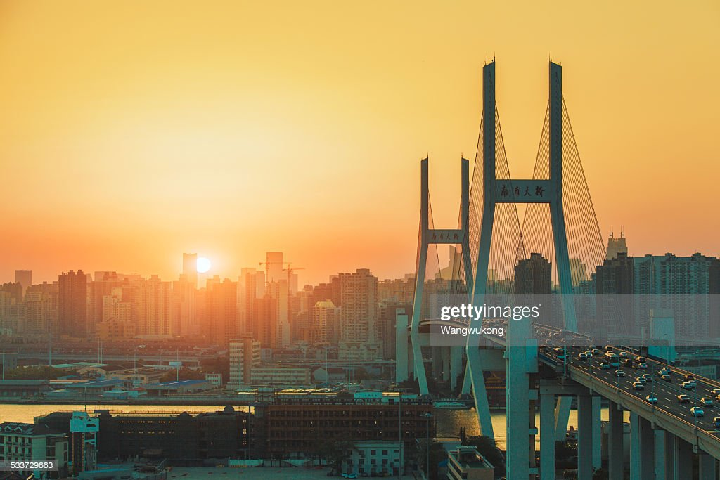 Nanpu Bridge in a slant of sunlight : Foto stock