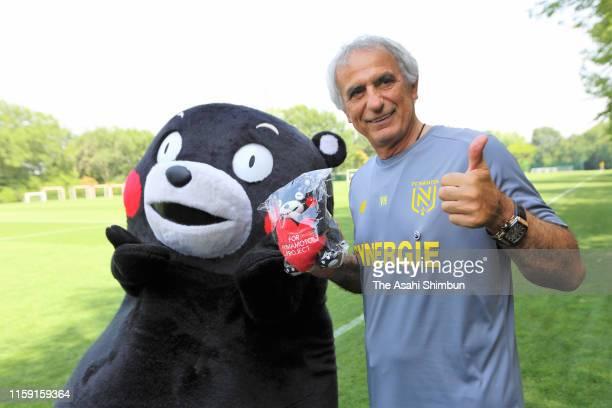 Nante head coach Vahid Halilhodzic interacts Kumamoto Prefecture mascot Kumamon at the Nante FC training ground on June 28, 2019 in Nantes, France.