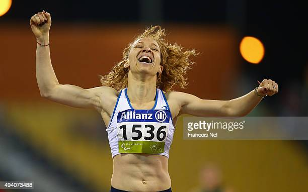 Nantein Keita of France celebrates winning the women's 400m T13 final during the Evening Session on Day Three of the IPC Athletics World...