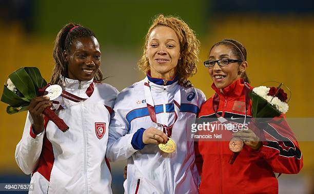 Nantein Keita of France poses with her gold medal Somaya Bousaid of Tunisia silver and Sanaa Benhama of Morocco bronze after the women's 400m T13...