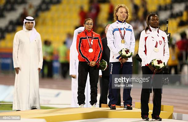 Nantein Keita of France stands for her anthem with her gold medal Somaya Bousaid of Tunisia silver and Sanaa Benhama of Morocco bronze after the...