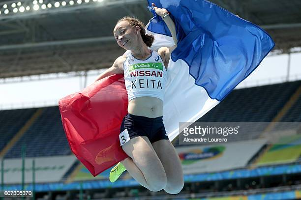 Nantenin Keita of France celebrates the victory in the Women's 400 meter T13 final at Olympic Stadium on day 10 of the Rio 2016 Paralympic Games at...