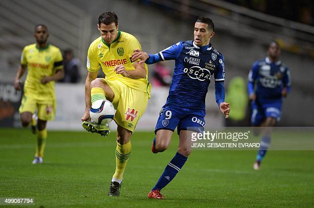 Nantes' Albanian defender Lorik Cana challenges Bastia's French forward Florian Raspentino during the French L1 football match between Nantes and...