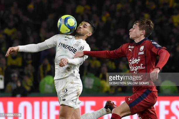Nantes' Algerian midfielder Mehdi Abeid controls the ball past Bordeaux's Croatian midfielder Toma Basic during the French L1 football match between...