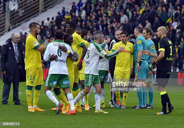 FC Nantes and Saint Etienne players cheer at the end of the French L1 football match between FC Nantes and AS Saint Etienne on November 232014 at the...