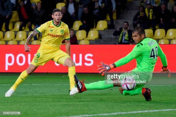 Nantes' Argentine forward Emiliano Sala kicks to score past Nice's Argentine goalkeeper Walter Benitez during the French L1 football match between...