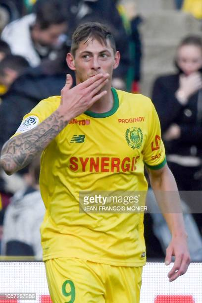 Nantes' Argentinian forward Emiliano Sala blows a kiss to supporters as he celebrates after scoring a goal during the French L1 football match...