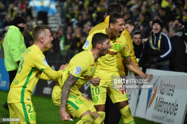 Nantes' Argentinian forward Emiliano Sala celebrates and Nantes' Moroccan forward Yacine Bammou celebrate after Sala scored a penalty during the...