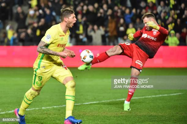 Nantes' Argentinian forward Emiliano Sala celebrates celebrates after he scored a penalty as Dijon's goalkeeper Baptiste Reynet kicks the ball during...