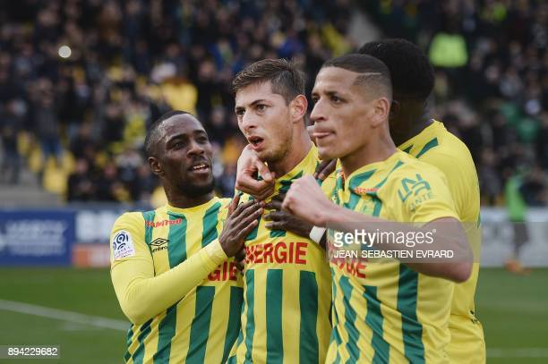 Nantes' Argentinian forward Emiliano Sala celebrates with his teammates after scoring a penalty during the French L1 football match between Nantes...