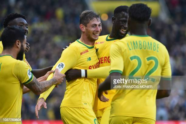 Nantes' Argentinian forward Emiliano Sala celebrates with teammates after scoring a goal during the French L1 football match between Nantes and...