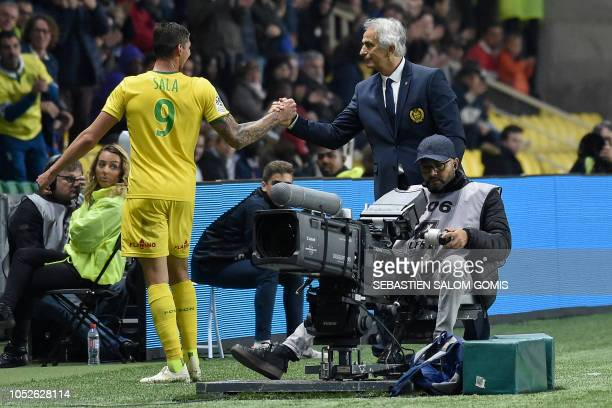 Nantes' Argentinian forward Emiliano Sala is congratulated by Nantes' Bosnian head coach Vahid Halilhodzic as he celebrates after scoring a third...