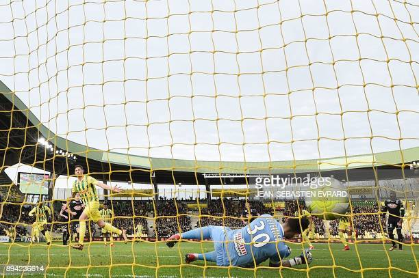 Nantes' Argentinian forward Emiliano Sala scores a penalty during the French L1 football match between Nantes and Angers at Beaujoire Stadium in...