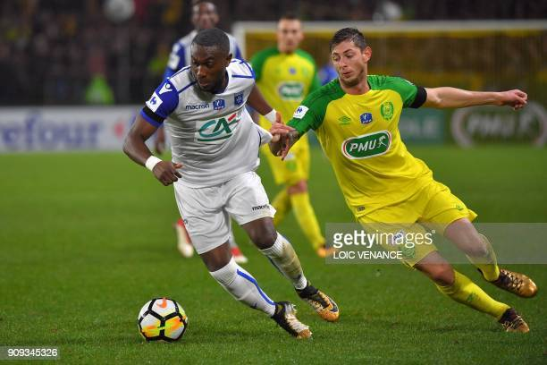 Nantes' Argentinian forward Emiliano Sala vies with Auxerre's French defender Bendjaloud Youssouf during the French Cup round of 32 football match FC...