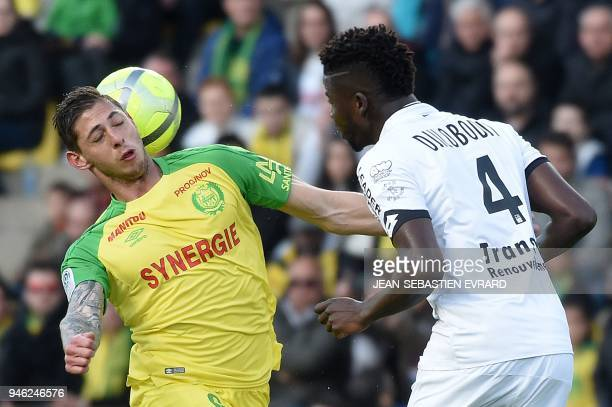 Nantes' Argentinian forward Emiliano Sala vies with Dijon's Senegalese defender Papy Djilobodji during the French L1 football match between Nantes...