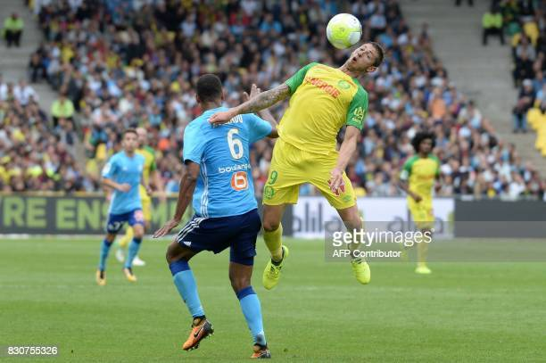 Nantes' Argentinian forward Emiliano Sala vies with Marseille's Portuguese defender Rolando during the French L1 football match between Nantes and...