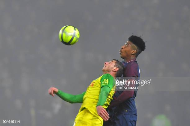 Nantes' Argentinian forward Emiliano Sala vies with Paris SaintGermain's French defender Presnel Kimpembe during the French L1 football match between...