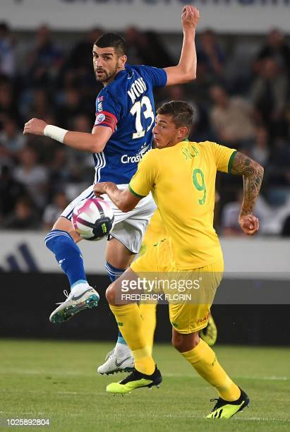 Nantes' Argentinian forward Emiliano Sala vies with Strasbourg's Serbian defender Stefan Mitrovic during the French L1 football match between...
