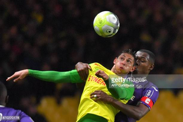 Nantes' Argentinian forward Emiliano Sala vies with Toulouse's French defender Issa Diop during the French L1 football match Nantes versus Toulouse...