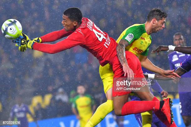 TOPSHOT Nantes' Argentinian forward Emiliano Sala vies with Toulouse's French goalkeeper Alban Lafont during the French L1 football match Nantes...
