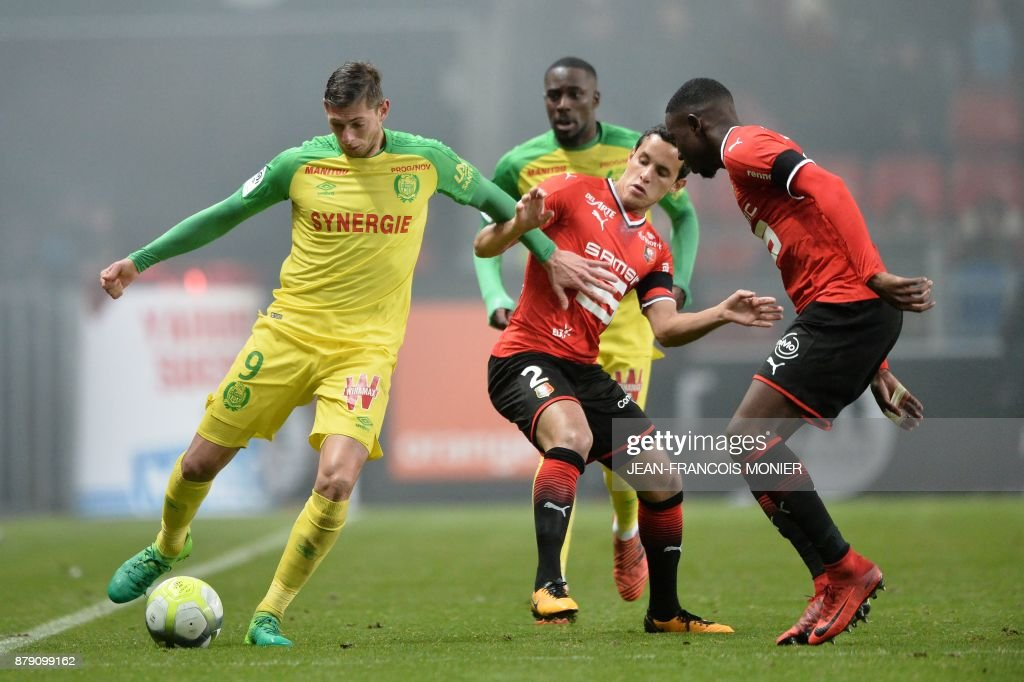Nantes' Argentinian Italian forward Emiliano Sala (L) fights for the ball with Rennes' Algerian defender Mehdi Zeffane (C) during the French L1 football match between Stade Rennais (Stade Resnais FC) and Nantes (FC Nantes)at The Roazhon Park, in Rennes, northwestern France on November 25, 2017. /