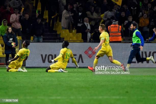 Nantes' Belgian forward Anthony Limbombe celebrates with Nantes' French midfielder Abdoulaye Toure and Nantes' French midfielder Valentin Rongier...