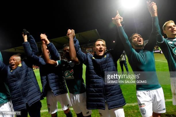 Nantes' Belgian forward Anthony Limbombe Nantes' French midfielder Valentin Rongier and Nantes' Brazilian defender Fabio Da Silva celebrate their...