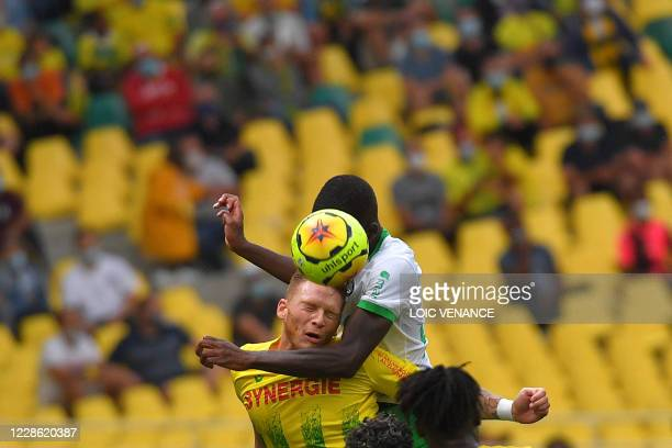Nantes' Belgian forward Renaud Emond heads the ball during the French L1 football match between Nantes and Saint-Etienne at La Beaujoire stadium in...
